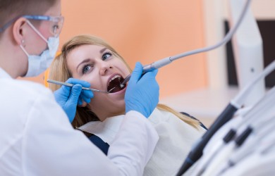 35650508 - dentist drilling a tooth of young woman